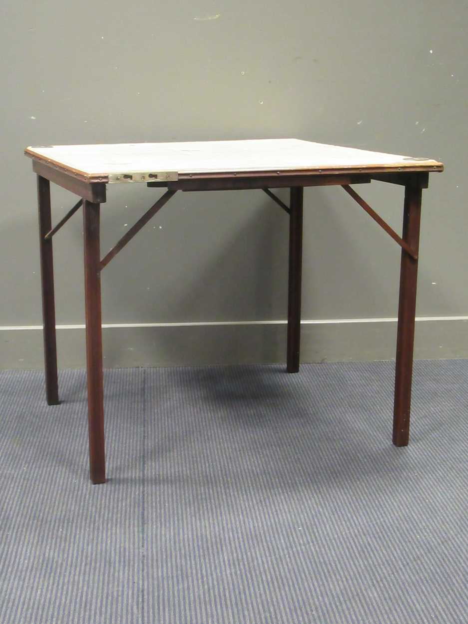 A Mudies squeezer card table with felt top and folding legs, top measures 86 x 86cm