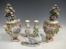 A pair of Meissen style floral encrusted vases and covers, 34cm high; a pair of floral encrusted
