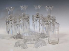 A pair of two-branch glass candlestick lustres, a cut glass bowl, pair of glass knife rests and a