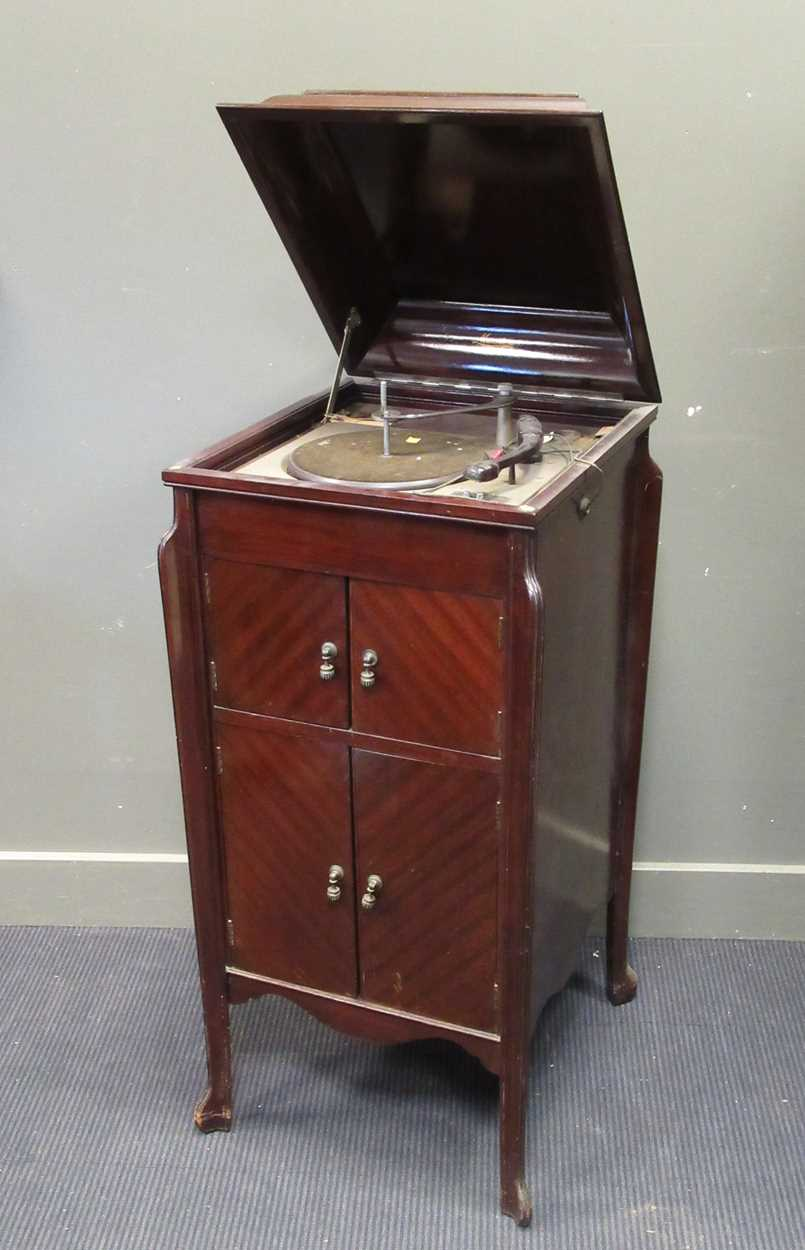 A gramophone cabinet with later electric turntable and an Edwardian cake stand (A/F)