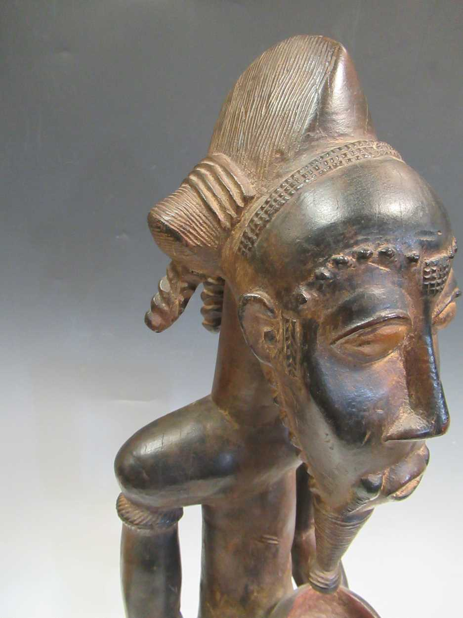A carved tribal figure of a man, 53cm high - Image 6 of 8