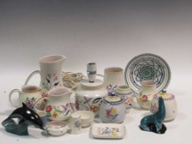 Items of Poole pottery to include a lamp, jugs and a model of a dolphin and a seal
