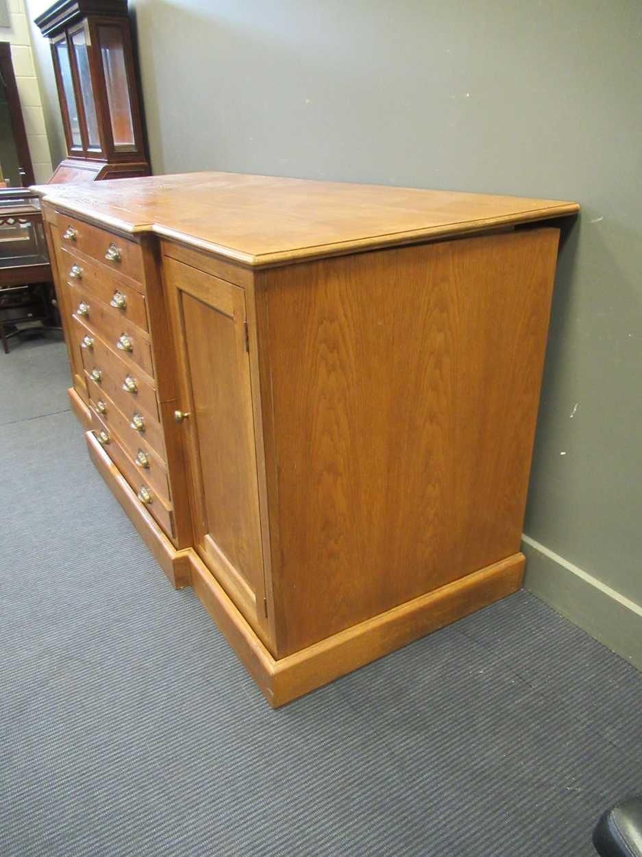 A 20th century blonde oak breakfront plan/ map chest, comprising of seven long drawers flanked by - Image 5 of 6