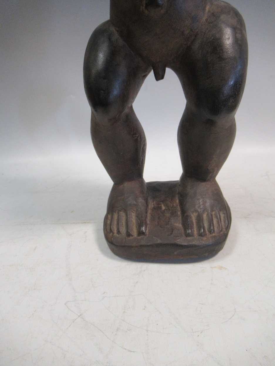 A carved tribal figure of a man, 53cm high - Image 5 of 8