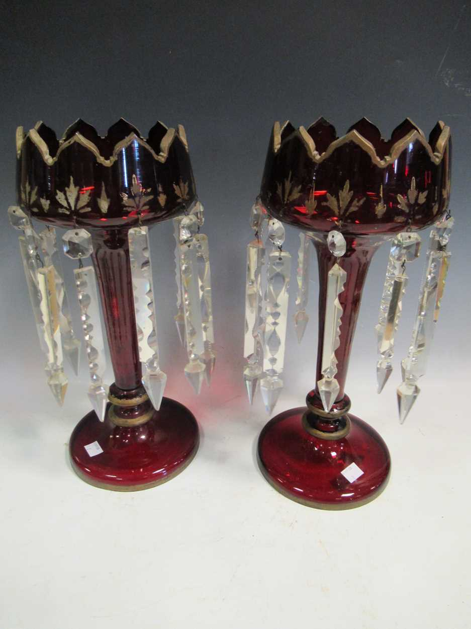A pair of Bohemian red glass lustres, with gilt decoration, 40cm high