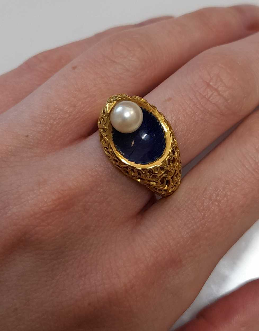 A modern enamel and pearl ring, set with a 6.2mm cultured pearl to one side, size O, unhallmarked, - Image 8 of 8