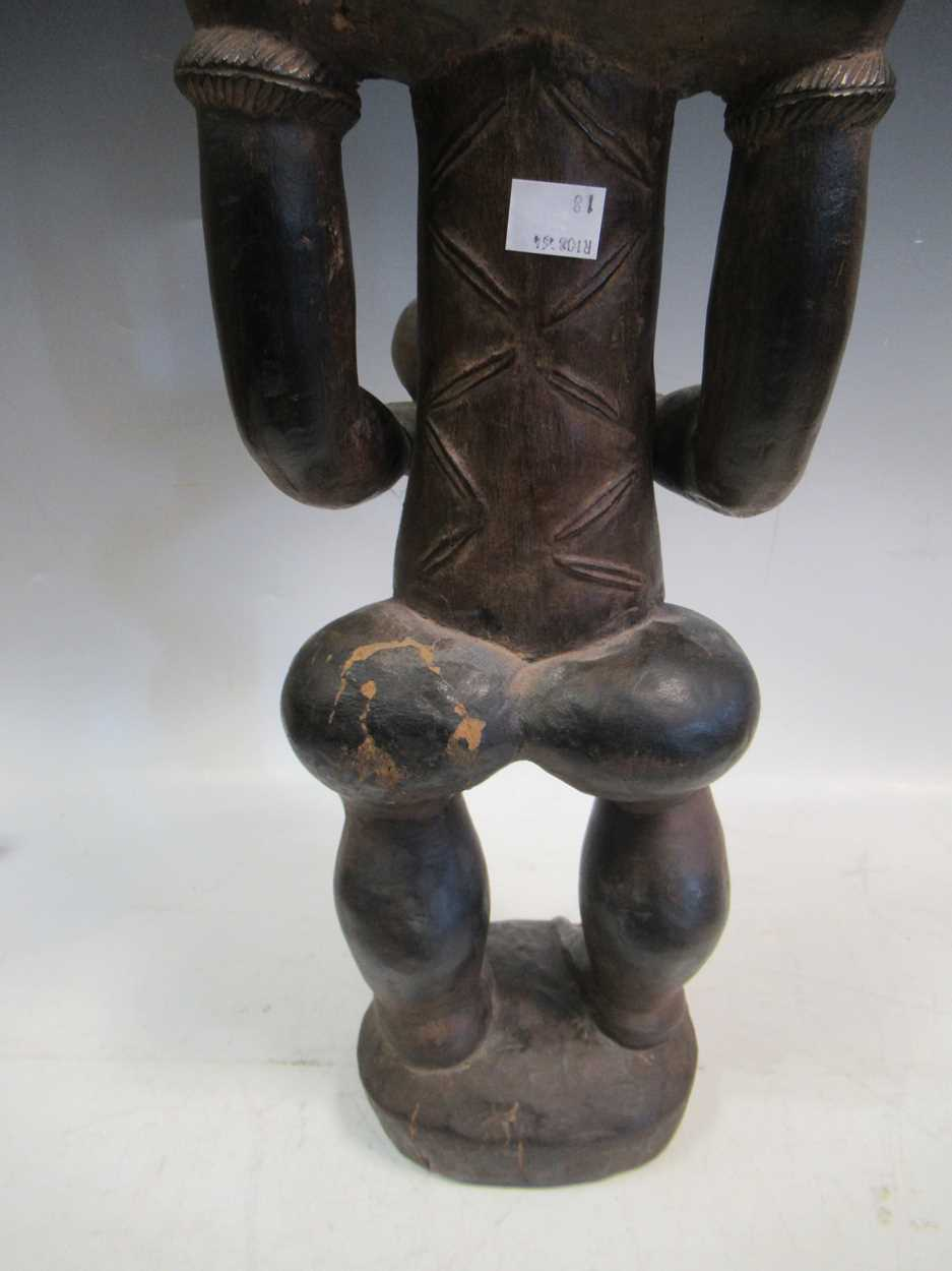 A carved tribal figure of a man, 53cm high - Image 8 of 8