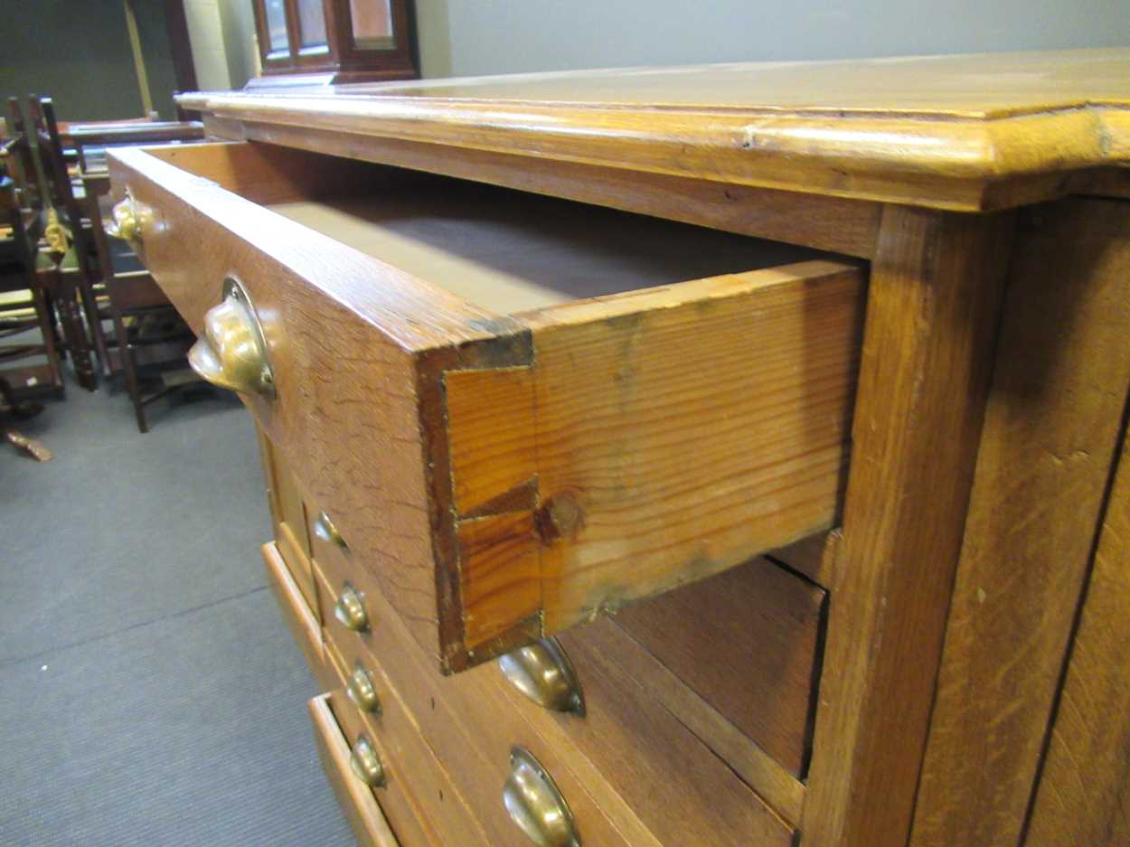 A 20th century blonde oak breakfront plan/ map chest, comprising of seven long drawers flanked by - Image 6 of 6
