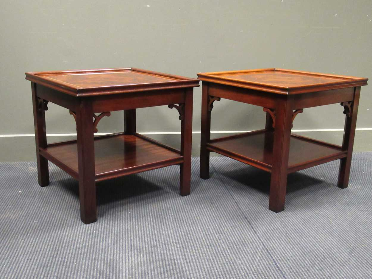 """A Pair of """"Charels Barr"""" Georgian style crossbanded flame mahogany lamp tables with undershelf and"""
