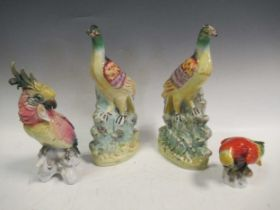 A pair of Staffordshire flat back models of birds; a continental porcelain model of a parrot and a