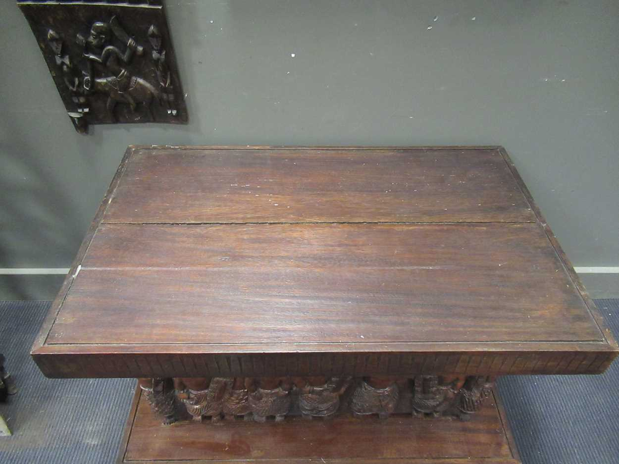 A Benin carved wood rectangular casket table 64 x 97 x 61cm together with a Benin carved wood - Image 5 of 10