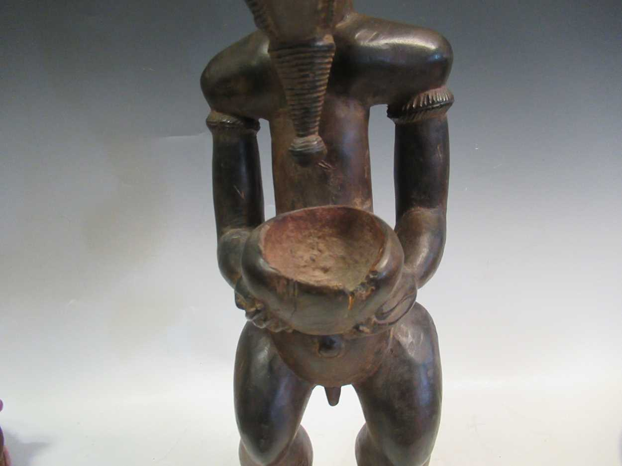 A carved tribal figure of a man, 53cm high - Image 7 of 8
