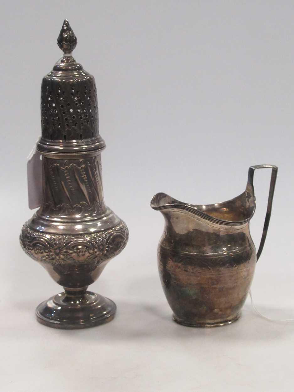 A Victorian vase sugar castor, repousse decoration, 23cm high, Sheffield 1899, maker HW for Lee &