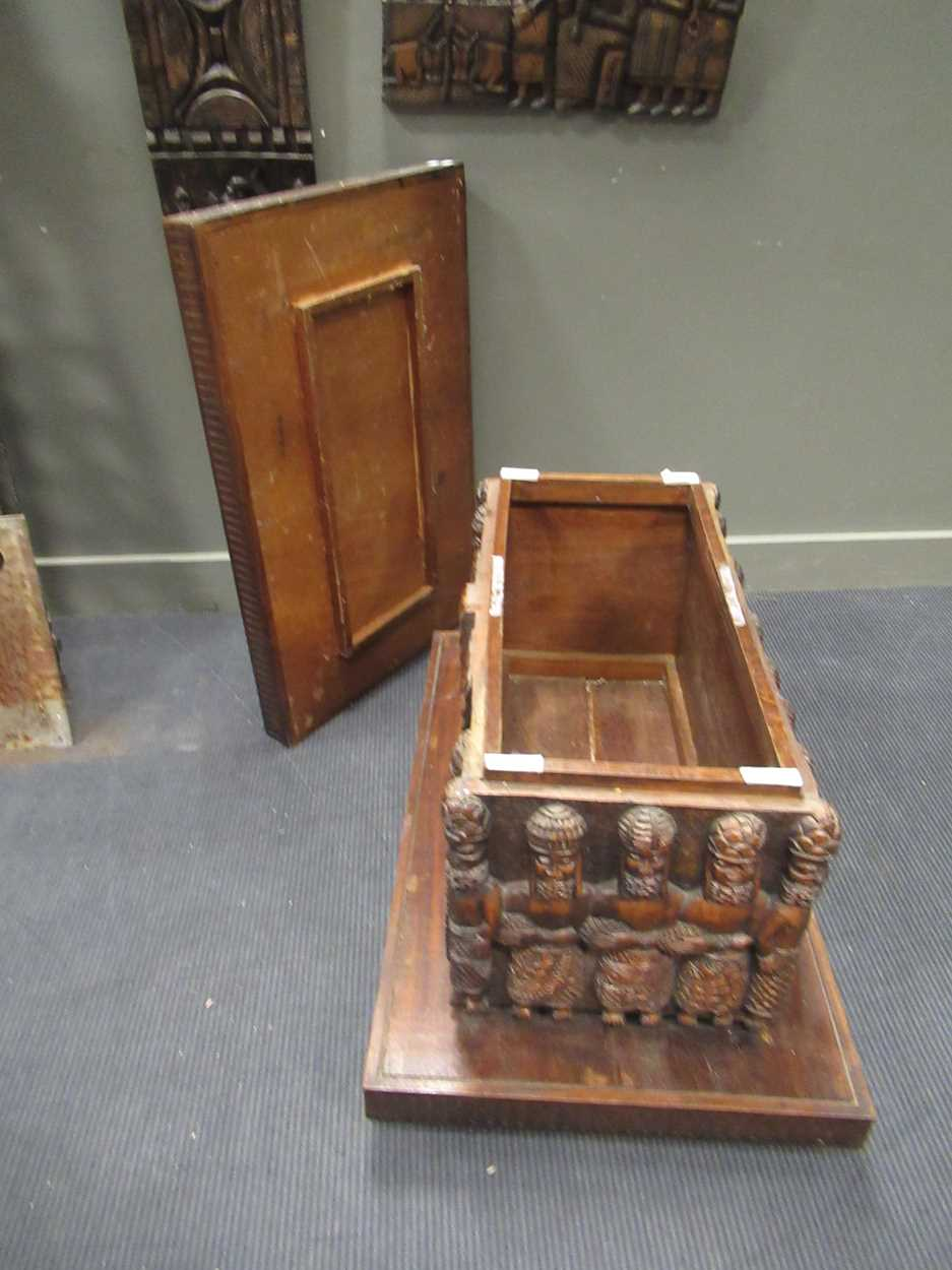 A Benin carved wood rectangular casket table 64 x 97 x 61cm together with a Benin carved wood - Image 3 of 10
