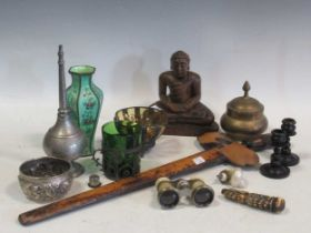 A glass walking stick, two other walking sticks, a Malay Kris, A carved handle, an enamel vase, a