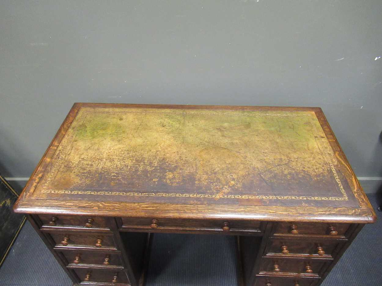 """A late Victorian oak twin pedestal writing desk stamped """"1209 Wilkinson & Son 8 Old Bond Street"""" the - Image 8 of 9"""