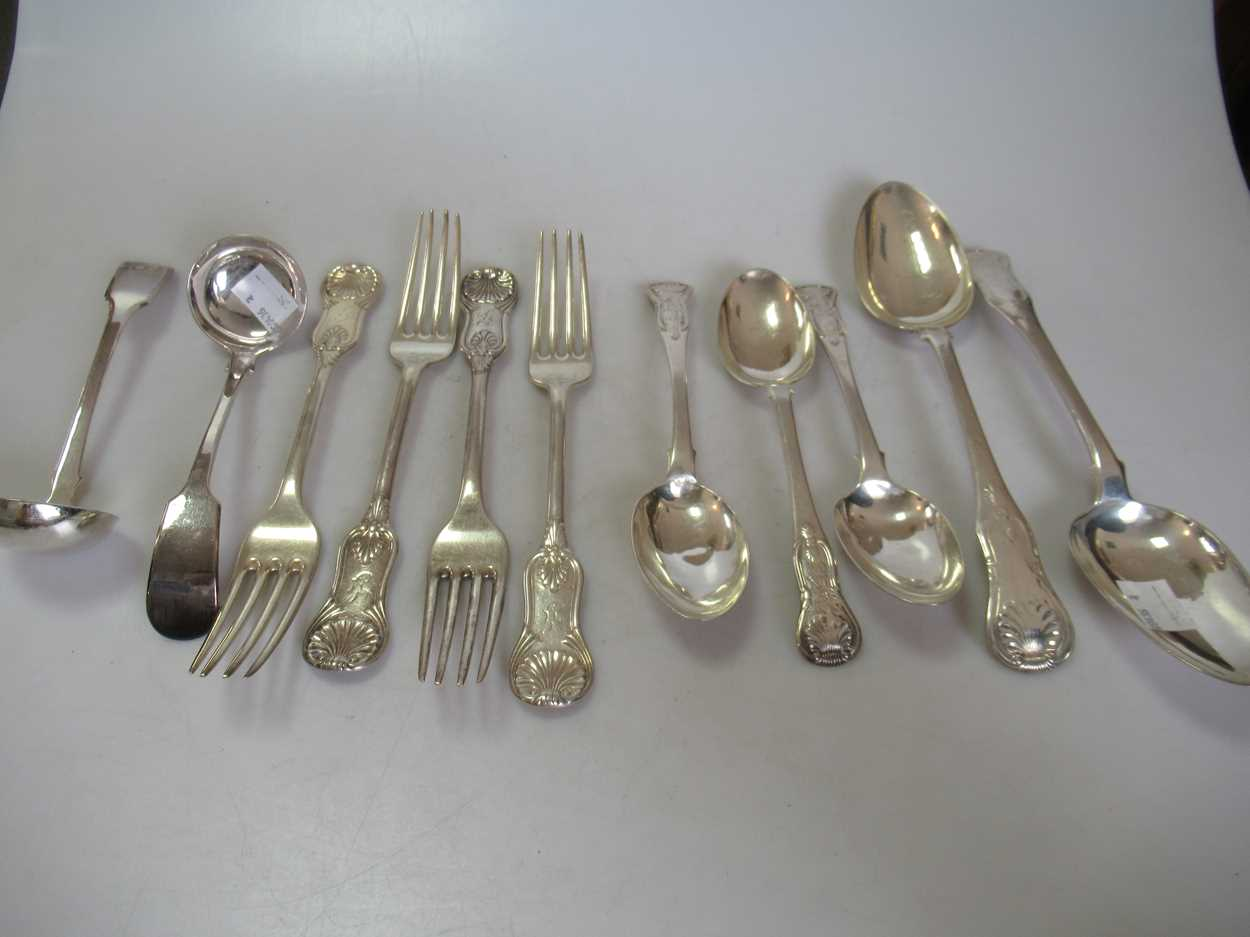 An assortment of Scottish silver flatware, 24.4ozt together with a pair of toddy ladles