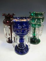 Three glass lustres, in green, blue and ruby, the tallest - 37cm high