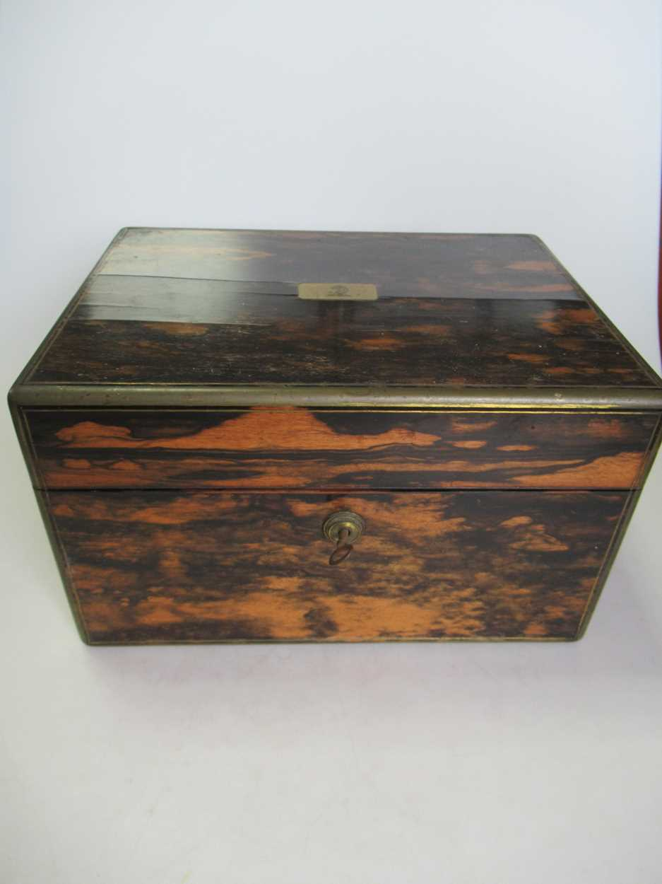 A coromandel fitted travelling dressing table box marked S.Mordan & Co, with brass plate engraved