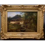 Follower of Frederick Richard Lee, RA (British, 1798-1879)A Watermill in a woodland landscape oil on