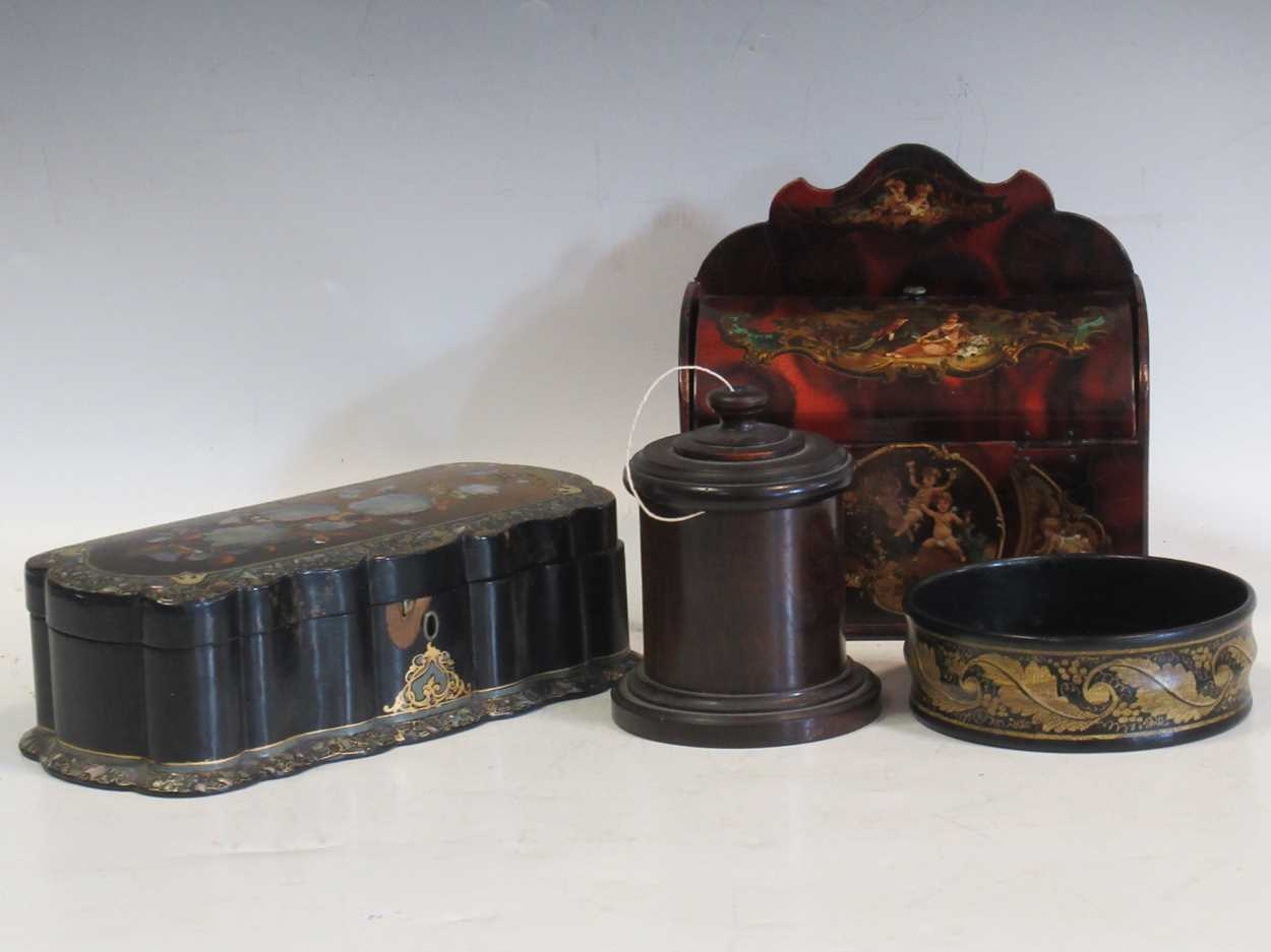 A 19th century string box, a black lacquered bottle coaster, a papier mache and mother of pearl box,