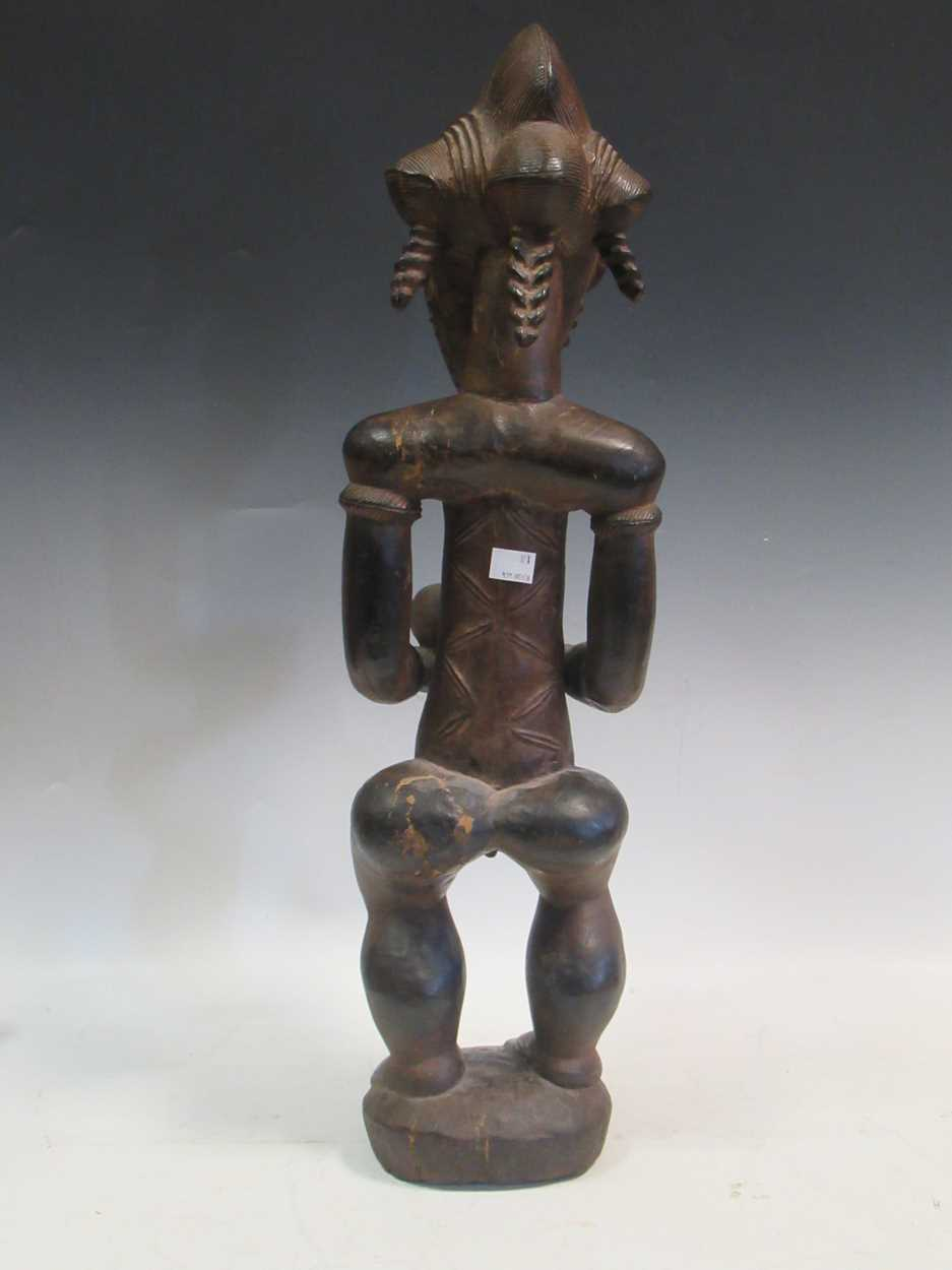 A carved tribal figure of a man, 53cm high - Image 4 of 8