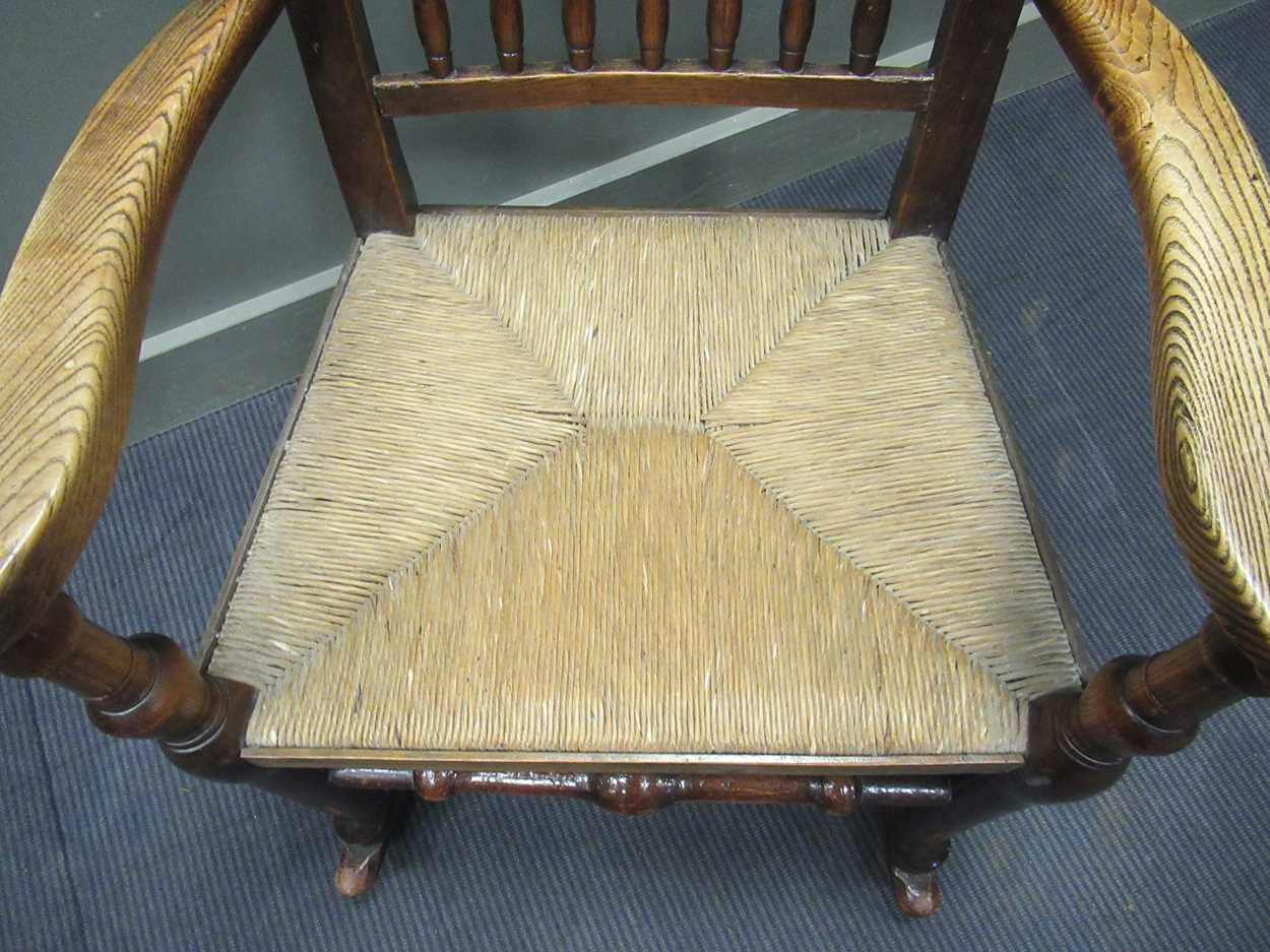 A rush seated stick back rocking chair 108cm high - Image 4 of 5