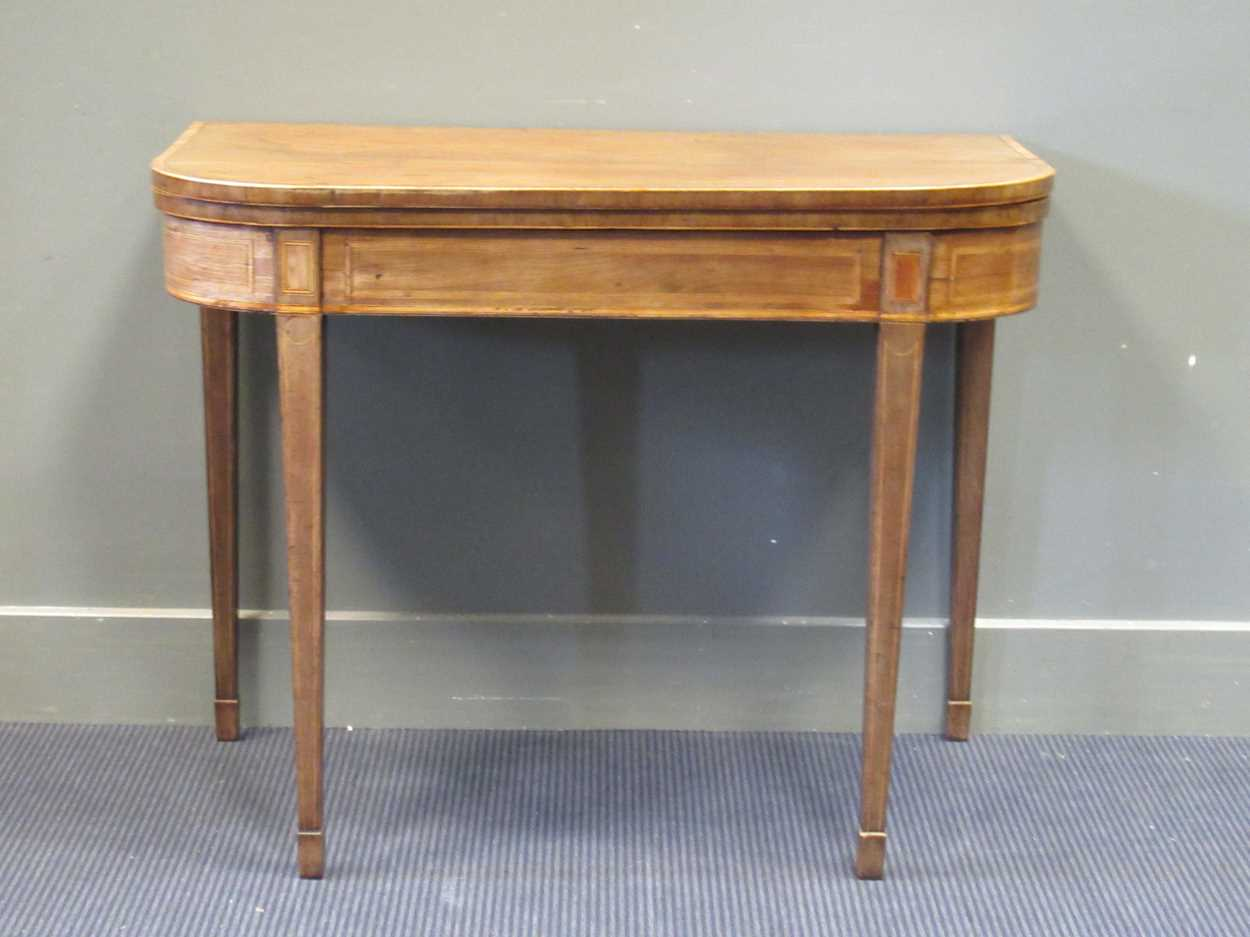 A George III inlaid mahogany card table on square tapered legs 72 x 92 x 45cm