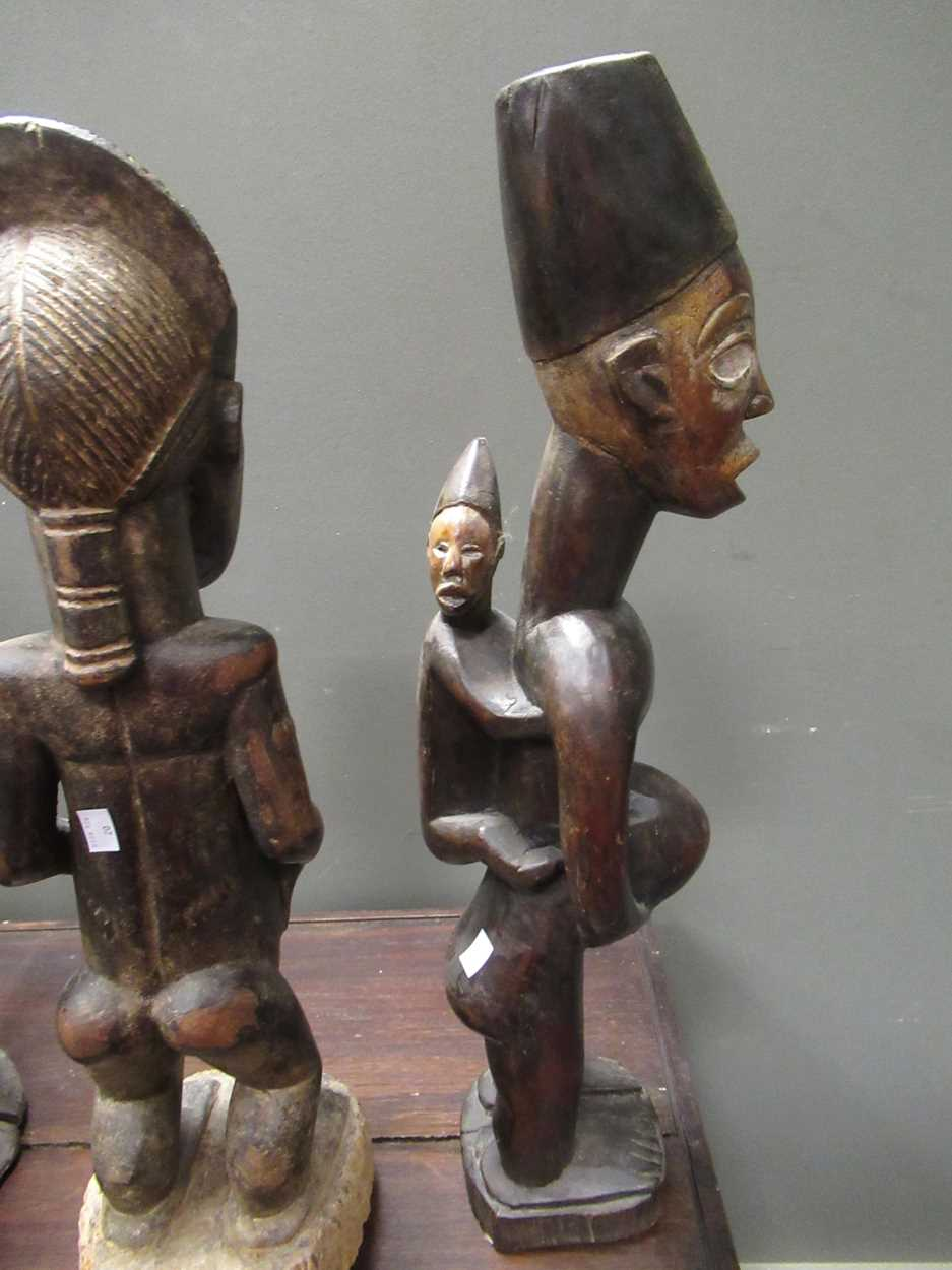 A Baule carved wood couple comprising of standing male and female figure 64cm high, together with - Image 2 of 4