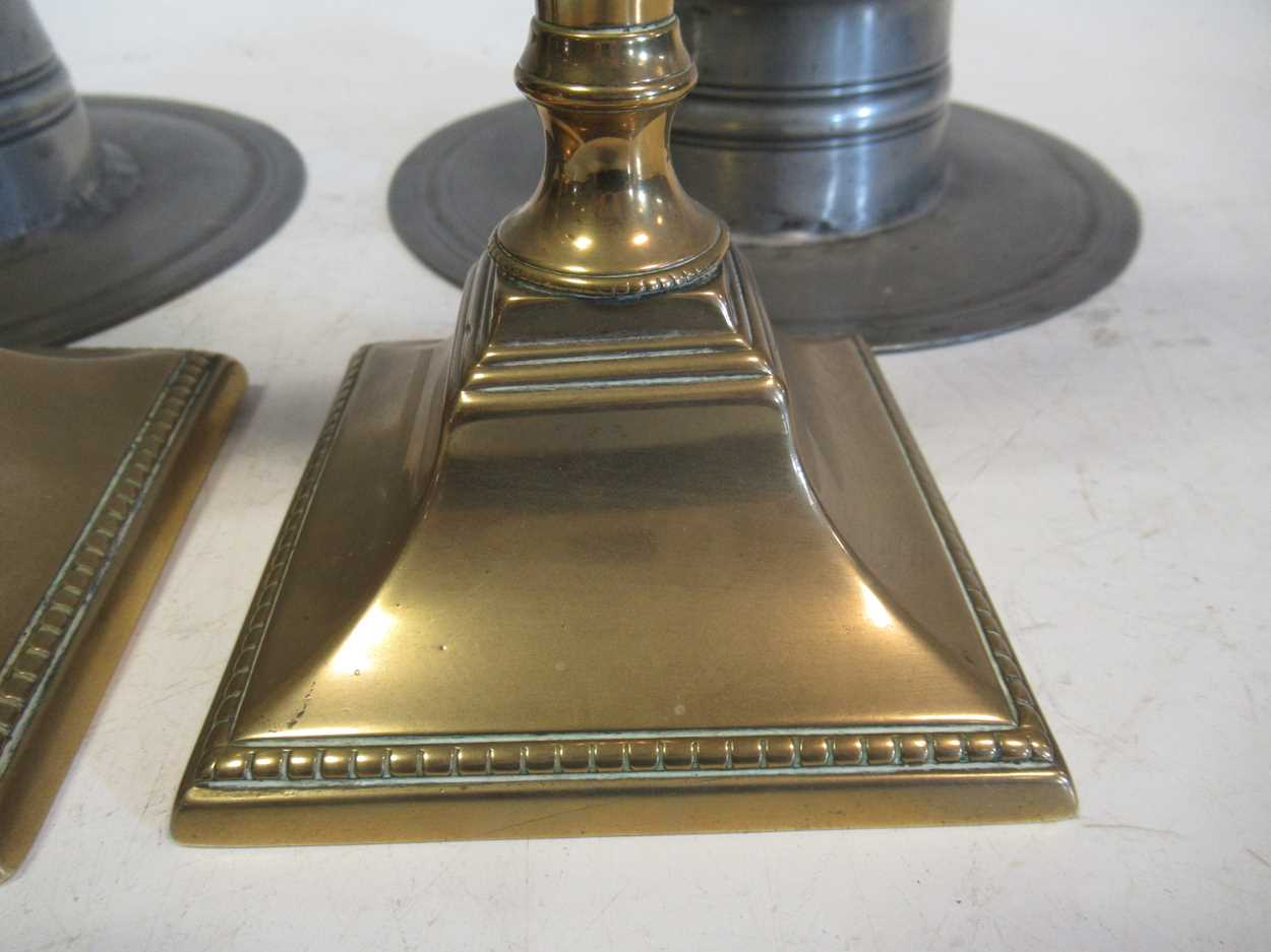 A pair of 18th century peweter inkwells and a pair of George III brass candlesticks - Image 2 of 5