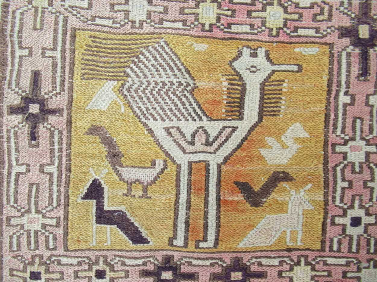 A tribal pale ground rug with bands of animals in squares and repeating border pattern, now - Image 2 of 11