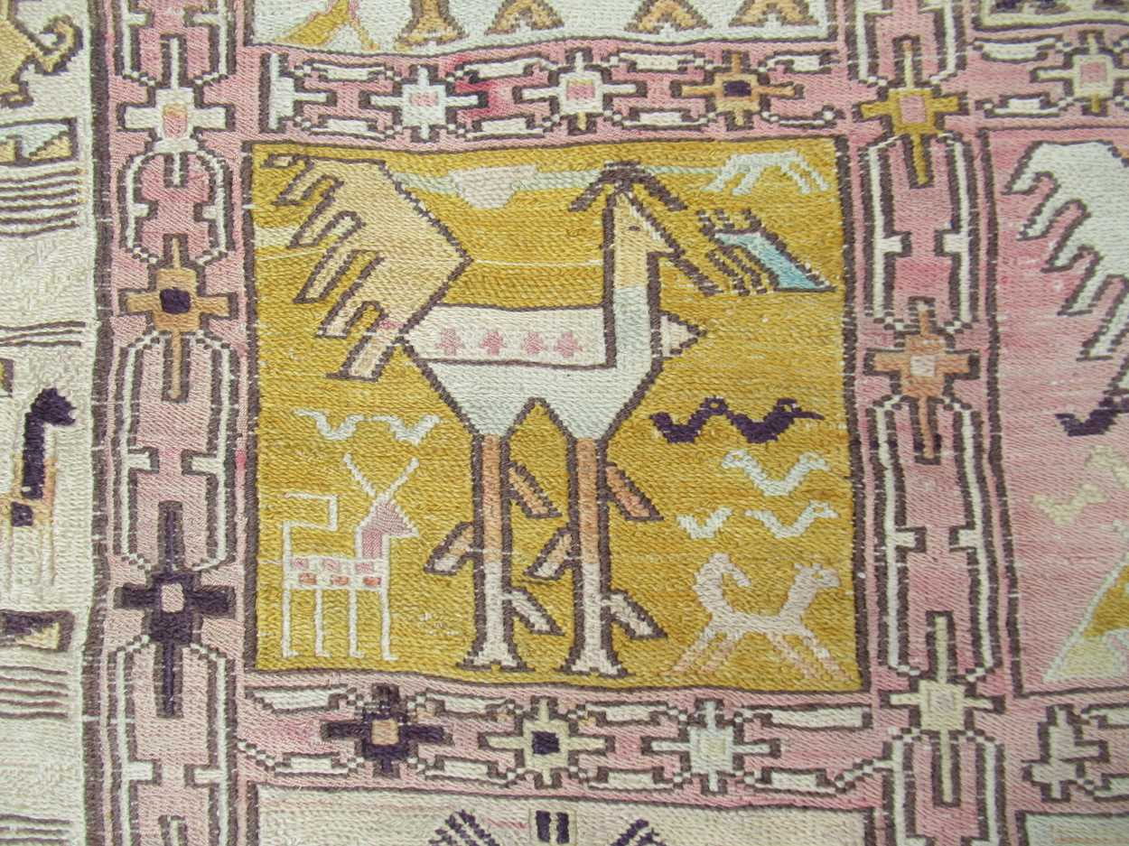 A tribal pale ground rug with bands of animals in squares and repeating border pattern, now - Image 7 of 11