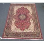 A Heriz type carpet with central medallion 337 x 250cmCondition report: Some fraying to the edges