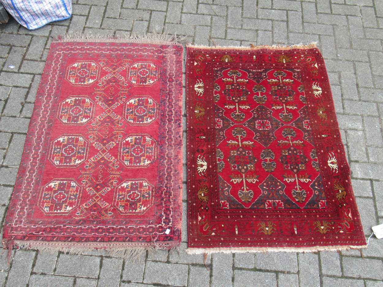 An Afghan rug, 132 x 83cm and a finely woven Baluchi rug, 128 x 87cm