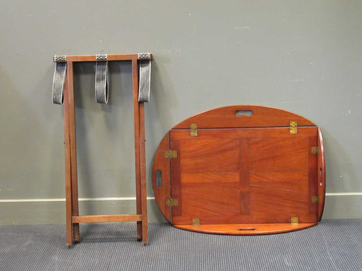 A mahogany butlers tray on folding stand (2)