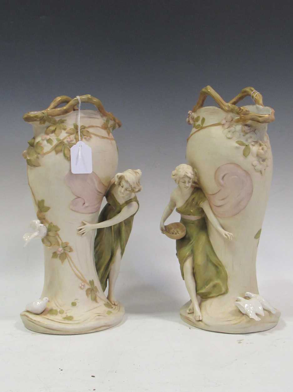 A pair of Royal Dux figural vases, applied pink triangle marks, stamped 1391 & 1392, 35cm high (2)