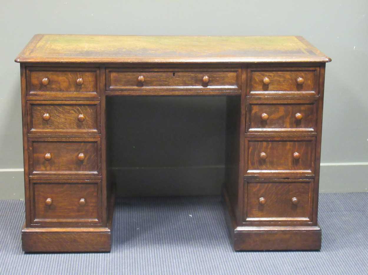 "A late Victorian oak twin pedestal writing desk stamped ""1209 Wilkinson & Son 8 Old Bond Street"" the"