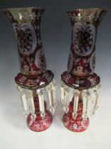 A pair of red glass candle lustres, 45cm high