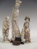 A collection of five ivory statues.