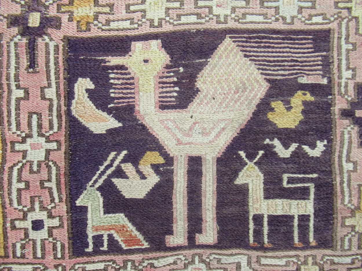 A tribal pale ground rug with bands of animals in squares and repeating border pattern, now - Image 3 of 11