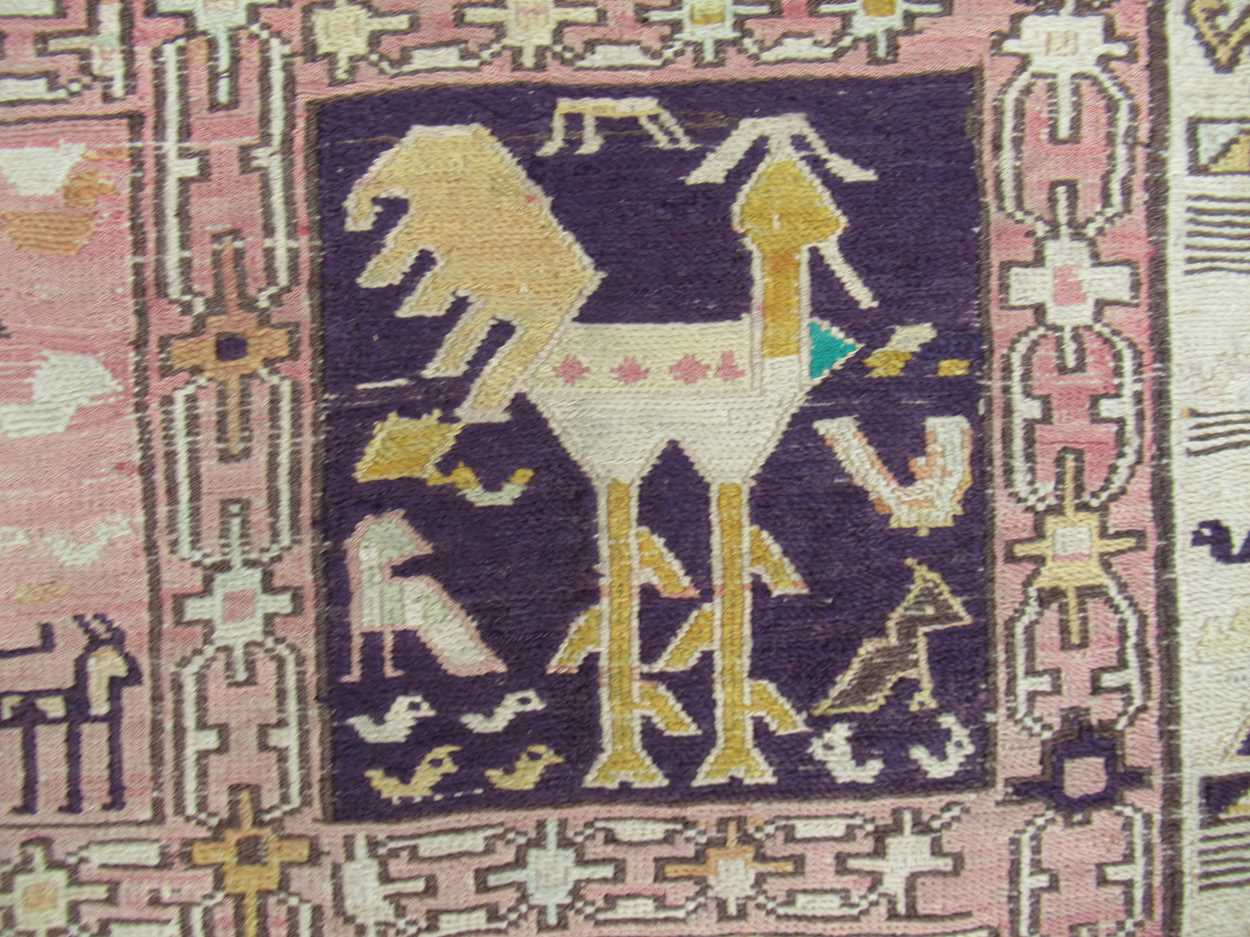 A tribal pale ground rug with bands of animals in squares and repeating border pattern, now - Image 9 of 11