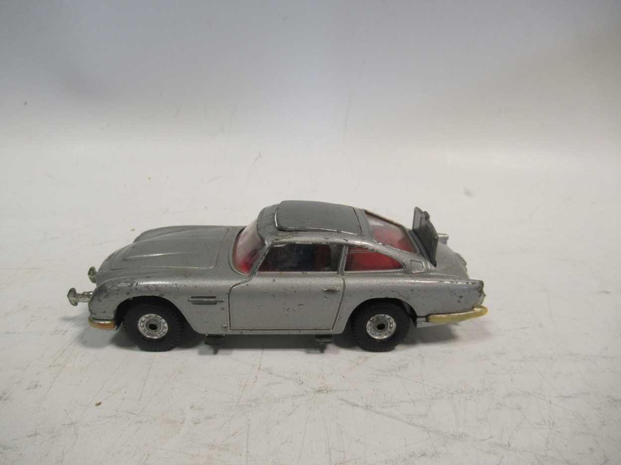 A collection of Corgi, Matchbox and Dinky diecast cars, including a Corgi 007 Aston Martin DB5, with - Image 2 of 11