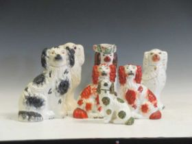 Three pairs of 19th century Staffordshire spaniels; six individual spaniels and spaniel toby jug