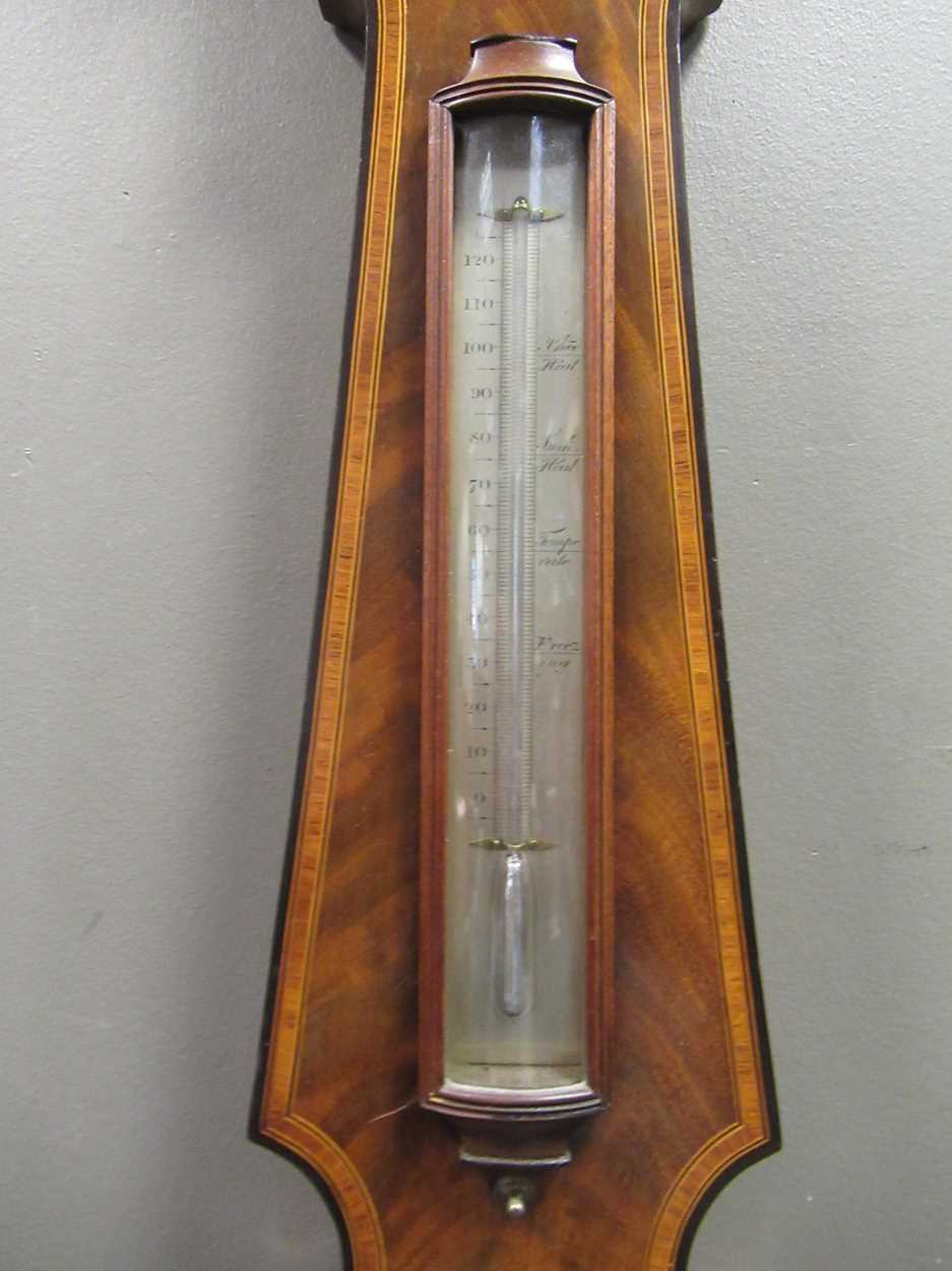 A Regency mahogany wheel barometer, maker Blandford, with silvered dial, the case with boxwood and - Image 9 of 10