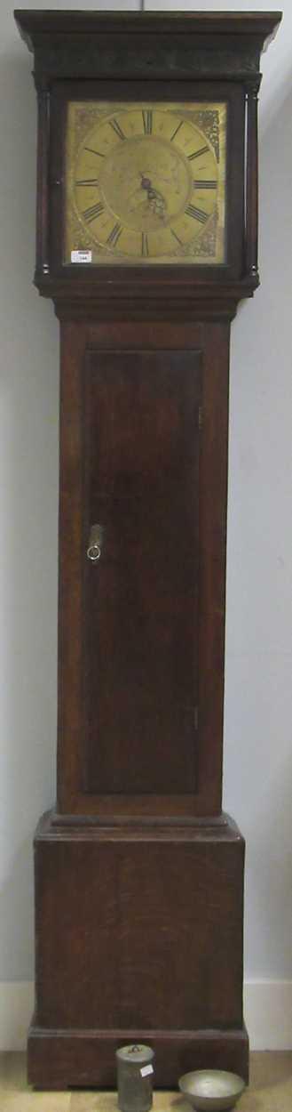 An oak 30 hour brass faced long case clock, maker Worcester