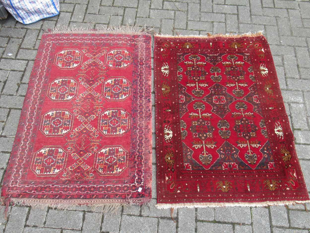 An Afghan rug, 132 x 83cm and a finely woven Baluchi rug, 128 x 87cm - Image 2 of 4