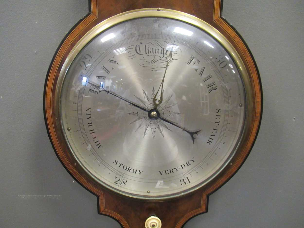 A Regency mahogany wheel barometer, maker Blandford, with silvered dial, the case with boxwood and - Image 10 of 10