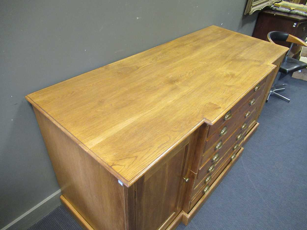 A 20th century blonde oak breakfront plan/ map chest, comprising of seven long drawers flanked by - Image 3 of 6