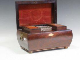 A good 19th century bombé tea caddy with specimen wood inlaid top