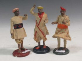 Three Indian painted plaster figures in traditional dress (3)